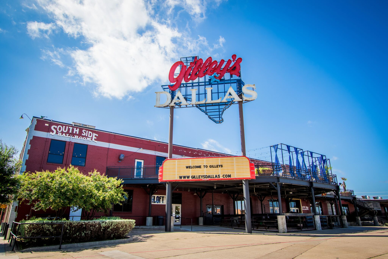 Gilley's indoor meeting space is located on the second floor, along with an outdoor patio just below their marquee sign.